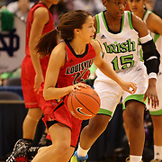 Jude Schimmel, Louisville, in action during the Notre Dame Fighting Irish V Louisville Cardinals Semi Final match during the Big East Conference, 2013 Women's Basketball Championships at the XL Center, Hartford, Connecticut, USA. 11th March. Photo Tim Clayton