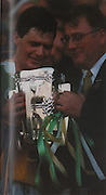 Hubert Rigney receives the McCarthy Cup from GAA President Joe McDonagh in 1998 for Offaly's 4th title in 17 years.