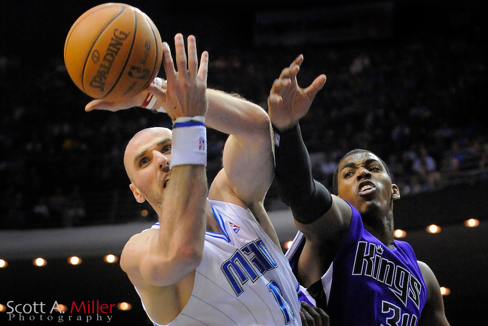 Jan. 22, 2010; Orlando, FL, USA; Orlando Magic center Marcin Gortat (13) and Sacramento Kings center Jason Thompson (34) fight for a rebound during the second half of the Magic's 100-84 win at Amway Arena. ©2010 Scott A. Miller
