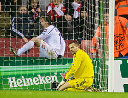 LIVERPOOL, ENGLAND - Wednesday, December 9, 2009: Liverpool's goalkeeper Diego Cavalieri looks dejected as AFC Fiorentina's Alberto Gilardino celebrates scoring an injury time winning goal during the UEFA Champions League Group E match at Anfield. (Photo by David Rawcliffe/Propaganda)