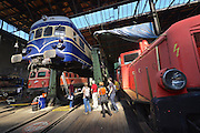 "Strasshof, Austria.<br /> Triebwagentage (railcar days) at Das Heizhaus - Eisenbahnmuseum Strasshof, Lower Austria's newly designated competence center for railway museum activities.<br /> Curator Rupert Gansterer (red polo shirt) with visitors at ÖBB 4145 ""Blauer Blitz (Blue Lightning)"", 1952-1962, running until 1997, undergoing an axle revision."