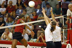 Stanford's Ogonna NNamani returns the ball towards the up-streched arms of 2 ISU defenders (possibly emily Kabbes on left and Laura Doornbos on right). The game and set was won by Stanford.  The match up took place at ISU's Redbird Arena in Normal Illinois on September 11, 2002.  The crowd was over 5600 and took the record for fans attending a volleyball game at Redbird, the MVC's record for number of fans watching a conference team and was the largest audience in the continental US thus far in the 2002 season<br />