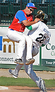 Bravehearts  Jordan Berry collides with the Navigators Nic Lops before he can reach first base.