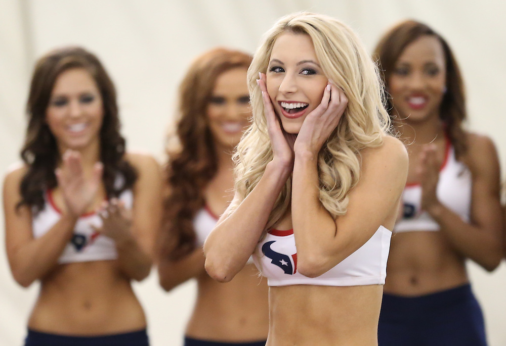 4/16/2014: Brittany M. is shocked to hear her name called. This was Brittany fourth year trying out for the team. Fifty girls showed up on April 16, 2014 at the Houston Texans practice facility in Houston, Texas to see which 35 girls made the 2014-2015, Houston Texans Cheerleading Team.
