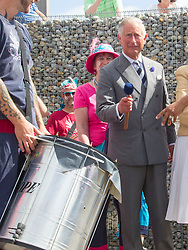WHITSTABLE- UK -29-JULY-2013: Britain's Prince Charles, The Prince of Wales accompanied by Camilla, The Duchess of Cornwall visit the harbour at Whitstable which is hosting an Oyster Festival. Charles and Camilla joined the local drum band on stage and then the Prince tried a sample of the local Oysters.<br /> Photograph by Ian Jones
