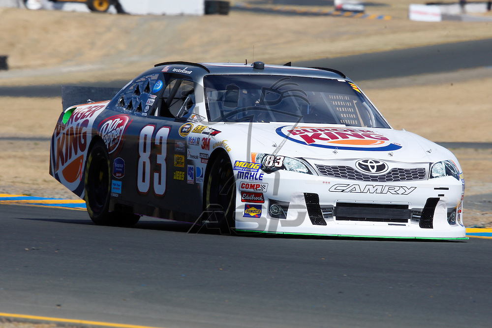 SONOMA, CA - JUN 22, 2012:  Landon Cassill (83) brings his car through turn 10 during a practice session for the Toyota Save Mart 350 at the Raceway at Sonoma in Sonoma, CA.