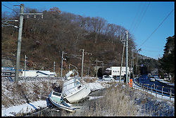 Boats lay beside the side of the road after being washed up by the tsunami,  one year on after the tsunami in  Shiogama City in Miyagi prefecture, Sunday February 5, 2012. Photo By Andrew Parsons/i-Images