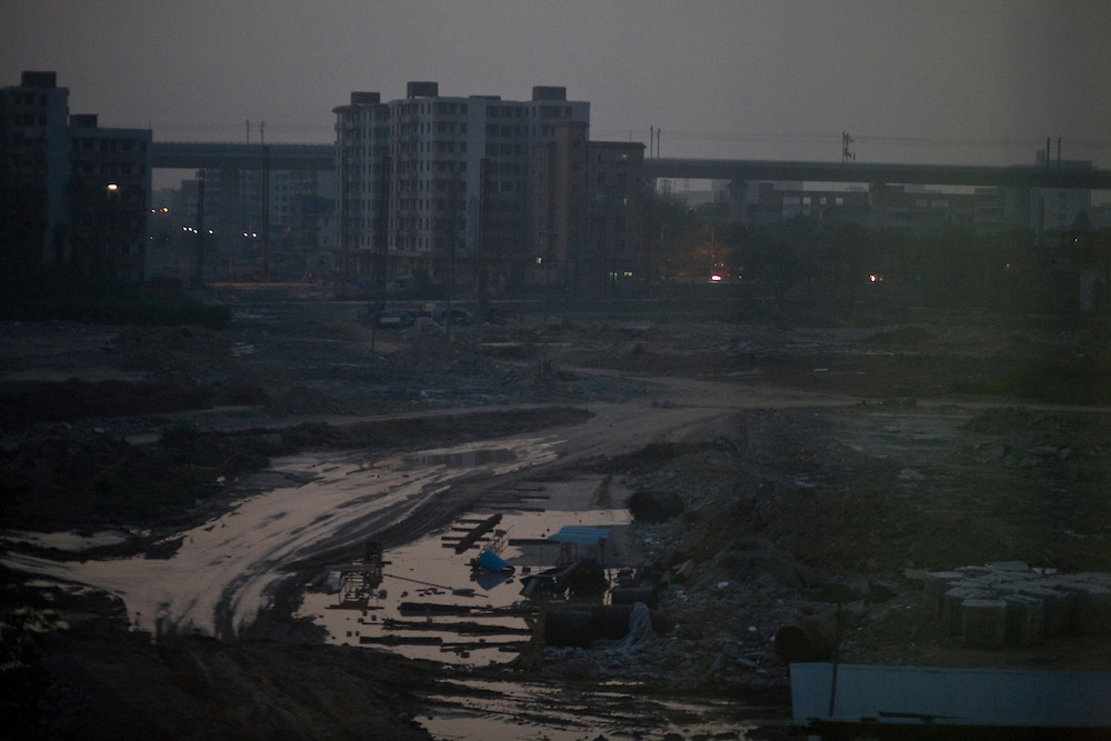 A construction site in the suburb of Guangzhou (fr: Canton) seen from the train to Beijing.