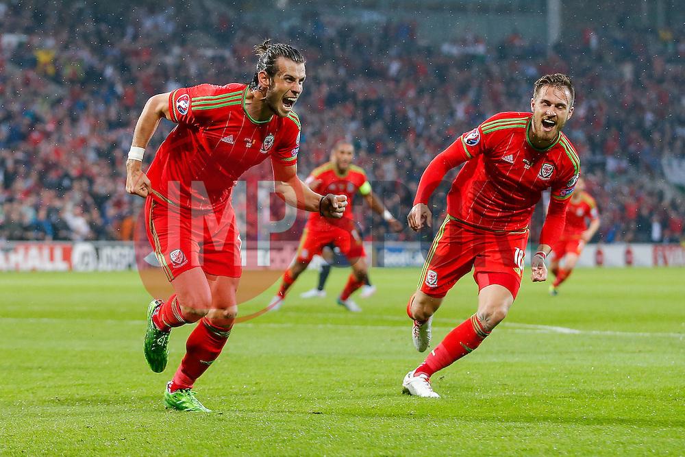 Gareth Bale of Wales (Real Madrid) celebrates scoring a goal to make it 1-0 - Photo mandatory by-line: Rogan Thomson/JMP - 07966 386802 - 12/06/2015 - SPORT - FOOTBALL - Cardiff, Wales - Cardiff City Stadium - Wales v Belgium - EURO 2016 Qualifier.