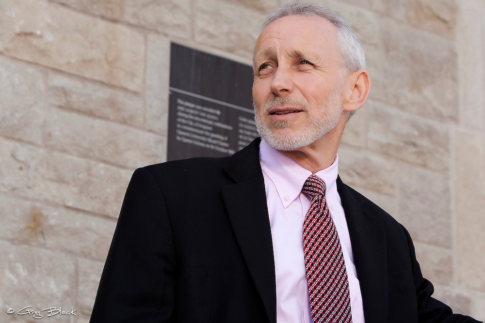 Provost Alan Harrison on steps of Richardson Hall