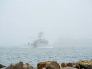 A lone lobster boat returns to port at Cape Forchu, Nova Scotia, Canada.