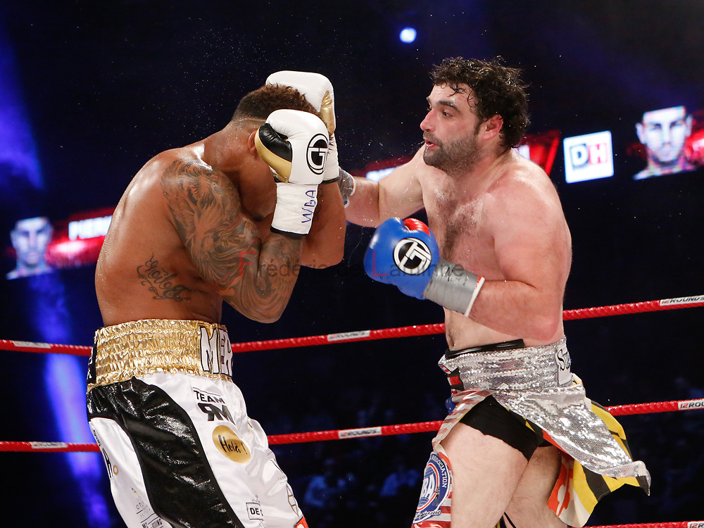 Charleroi, Belgium. 16 Dec, 2017. Ryad Merhy (left) protect himself from an attack from Nick Kisner during the WBA Inter-Continental cruiserweight title fight between Ryad Merhy (Belgium, 23/0/0) and Nick Kisner (USA,19/3/1) in Charleroi, Belgium. Merhy won with a 4th round KO. © Frédéric de Laminne
