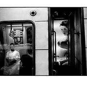 """Autor de la Obra: Aaron Sosa<br /> Título: """"Serie: Venezuela Cotidiana""""<br /> Lugar: Metro de los Dos Caminos, Caracas - Venezuela.<br /> Año de Creación: 1999<br /> Técnica: Captura digital en RAW impresa en papel 100% algodón Ilford Galeríe Prestige Silk 310gsm<br /> Medidas de la fotografía: 33,3 x 22,3 cms<br /> Medidas del soporte: 45 x 35 cms<br /> Observaciones: Cada obra esta debidamente firmada e identificada con """"grafito – material libre de acidez"""" en la parte posterior. Tanto en la fotografía como en el soporte. La fotografía se fijó al cartón con esquineros libres de ácido para así evitar usar algún pegamento contaminante.<br /> <br /> Precio: Consultar<br /> Envios a nivel nacional  e internacional."""