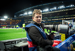 Photographer Vid Ponikvar prior to the football match between Chelsea FC and NK Maribor, SLO in Group G of Group Stage of UEFA Champions League 2014/15, on October 21, 2014 in Stamford Bridge Stadium, London, Great Britain. Photo by Vid Ponikvar / Sportida.com