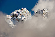 """Sagarmatha National Park: This is the north side of Ama Dablam, a beautiful mountain in the Himalaya range of eastern Nepal, in the Khumbu District. This was photographed between Dingboche and Chhukhung, in the Imja Khola river valley. Ama Dablam was first climbed in 1961. The main peak is 22,349 feet (or 6,812 meters) tall, and the lower western peak is 18,251 feet (or 5,563 meters). Ama Dablam means """"Mother and Pearl Necklace"""" (the pearl being the perennial hanging glacier)."""