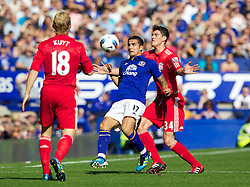LIVERPOOL, ENGLAND - Saturday, October 1, 2011: Liverpool's Martin Kelly in action against Everton's Tim Cahill during the Premiership match at Goodison Park. (Pic by Vegard Grott/Propaganda)