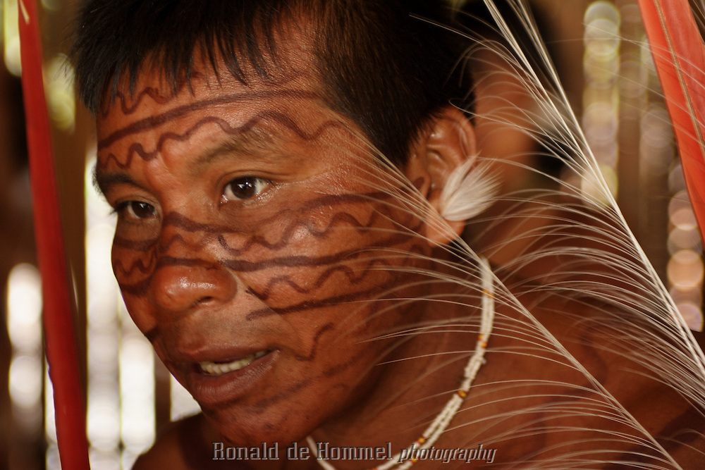 Viriunaveteri, Venezuela. A Yanomami shaman watching a tribal dance. .The village of Viriunaveteri consists of 15 huts around a muddy square. It's situated in the Venezuelan Amazone several days by boat from the nearest town. This community on the banks of the Casiquiare is one of the few Yanomami villages that actually has some contact with the outside world. Most other tribes live deeper in the jungle.