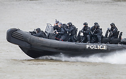 © Licensed to London News Pictures.19/03/2017.London, UK. Armed police arrive by boat as they prepare to board a cruise boat during an ant-terrorist training exercise on The River Thames in London. It is the first time that an exercise of this type has taken place on the river.Photo credit: Peter Macdiarmid/LNP