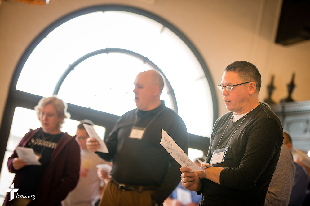 Navy Reserve Chaplain Ron Cox prays with other chaplains at the 2015 West Coast Lutheran Chaplains Professional Development Seminar Thursday, Jan. 29, 2015, at North Island Naval Air Station in San Diego, Calif. LCMS Communications/Erik M. Lunsford