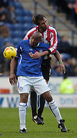 Photo: Leigh Quinnell.<br /> Leicester City v Southampton. Coca Cola Championship.<br /> 05/11/2005. Southamptons Claus Lundekvam jumps with Leicesters Dion Dublin.