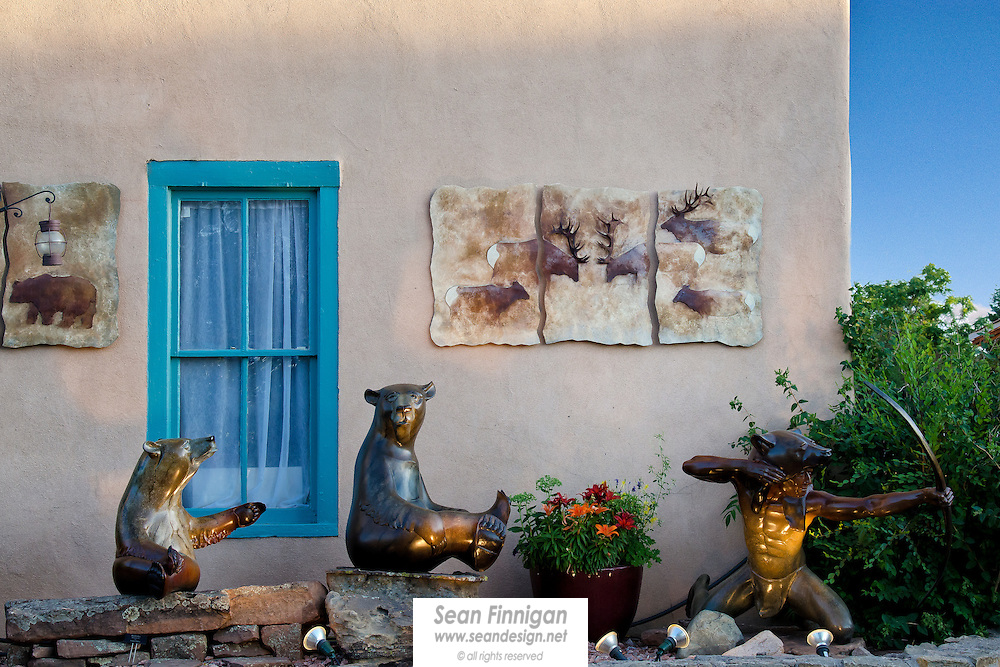 Statues of bears and a bear headed hunter outside an art gallery in Santa Fe, New Mexico