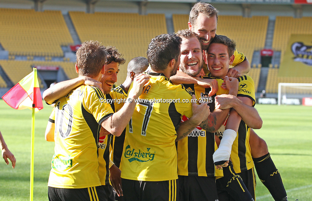 Phoenix players celebrate the 1st of Jeremy Brockies 2 goals during the A-League football match between the Wellington Phoenix & Brisbane Roar at Westpac Stadium, Wellington. 4th January 2015. Photo.: Grant Down / www.photosport.co.nz