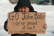Kevin Apok welcomes John Baker to White Mountain with a sign on Monday.