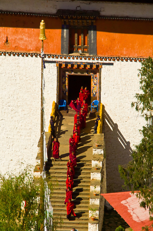 Procession leaving the Paro Dzong to the Paro Tsechu (festival), Paro, Bhutan