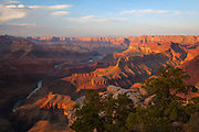Sunset from Zuni Point on the South Rim of Grand Canyon National Park with the Colorado River far below.