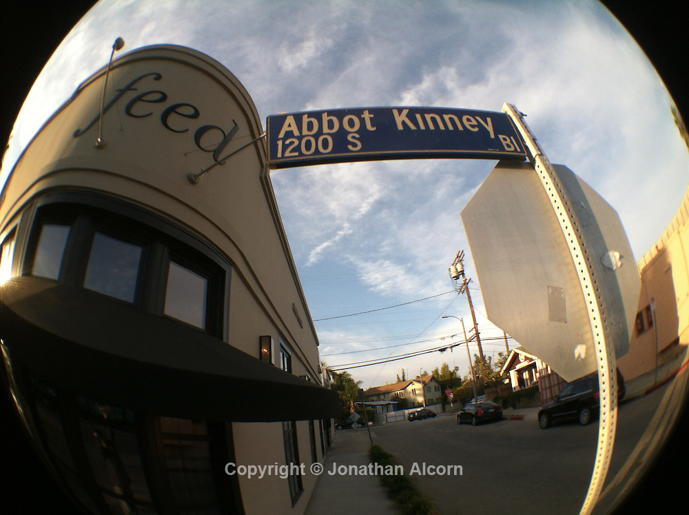 iPhone image of First Fridays on Abbot Kinney Boulevard which was recently declared ?The Coolest Block in America.? by GQ magazine. The trendy and chic stretch is populated with retail stores, restaurants, bars and galleries lining the street.  ©Jonathan Alcorn