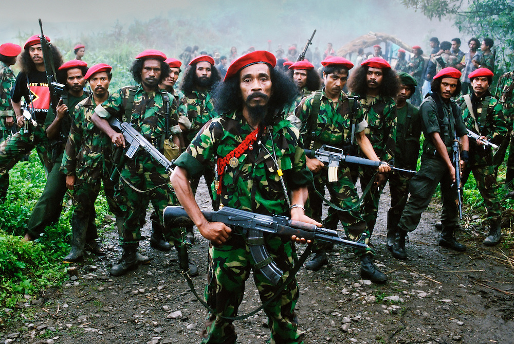 Falintil Commander Cornelio Gama, with some of his guerrilla force. <br /> <br /> Falintil meaning: 'National Army Front for East Timor Liberation'. <br /> <br /> The red berets are worn on special occasions and only by soldiers who are veterans of the conflict.<br /> <br /> East Timor, March 1999.