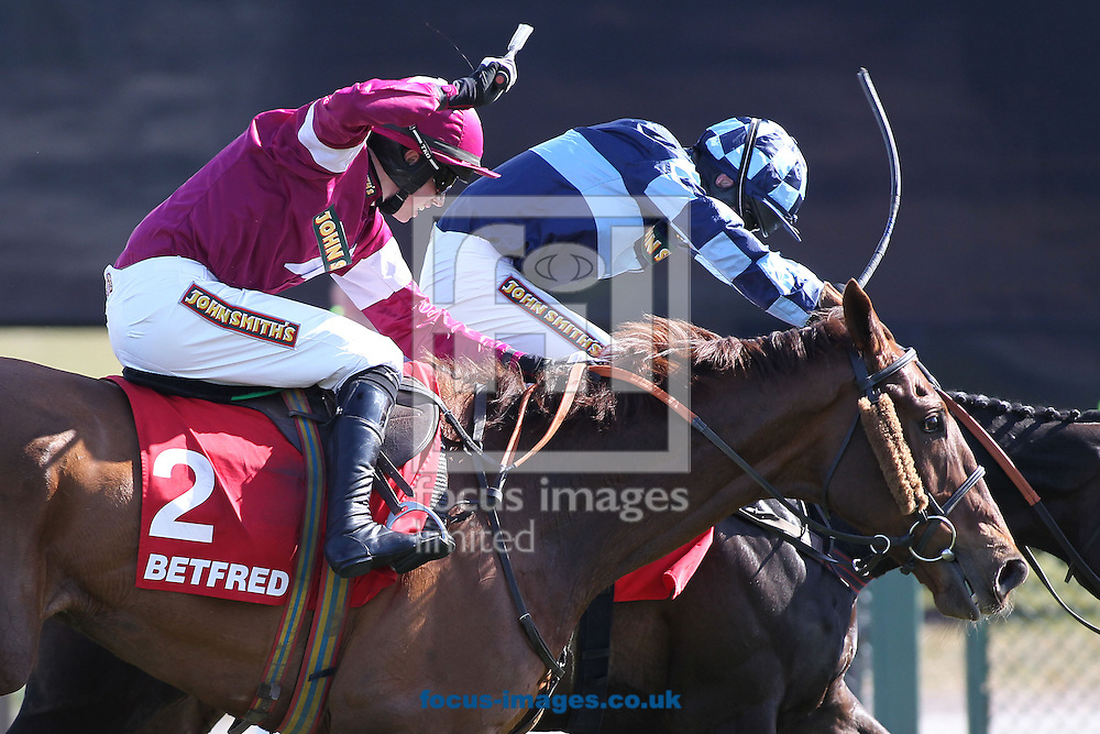 Picture by Michael Sedgwick/Focus Images Ltd +44 7900 363072.04/04/2013.First Lieutenant (2) ridden by Bryan Cooper battles past Menorah ridden by Richard Johnson to win The Betfred Bowl Steeple Chase during the John Smith's Grand National Meeting Day One at Aintree Racecourse, Aintree.