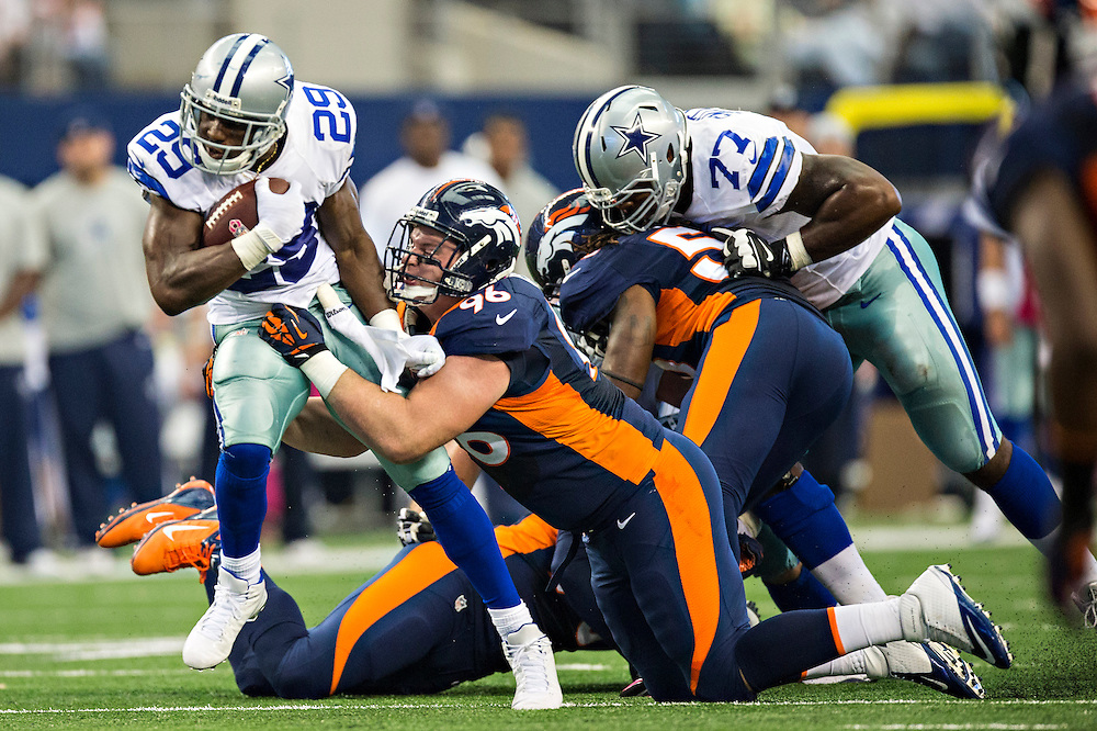 ARLINGTON, TX - OCTOBER 6:  DeMarco Murray #29 of the Dallas Cowboys is tackled by Mitch Unrein #96 of the Denver Broncos at AT&T Stadium on October 6, 2013 in Arlington, Texas.  The Broncos defeated the Cowboys 51-48.  (Photo by Wesley Hitt/Getty Images) *** Local Caption *** DeMarco Murray; Mitch Unrein