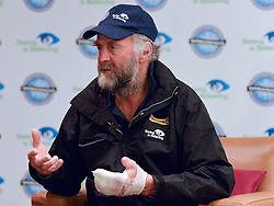 "© Licensed to London News Pictures. 04/03/2013. Heathrow, UK SIR RANULPH FIENNES with a bandaged left hand. Explorer Sir Ranulph Fiennes returns to the UK after pulling out of ""The Coldest Journey"" Expedition to the Antarctic at winter due to frostbite. The Coldest Journey Press Conference today 4th March 2013 at Heathrow Airport. Photo credit : Stephen Simpson/LNP"