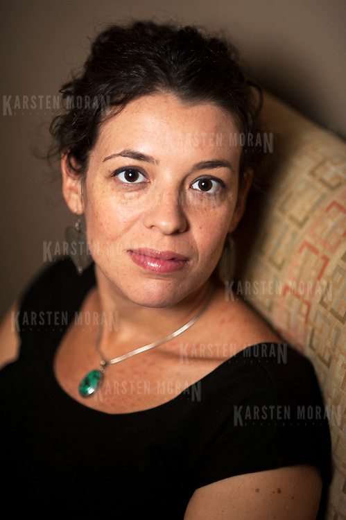 November 19, 2012 - New York, NY : Portrait of author and Pulitzer Prize-winning (for drama) playwright Quiara Alegria Hudes, taken on Monday, November 19 in her Washington Heights apartment. CREDIT: Karsten Moran for The New York Times