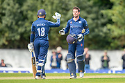 Scotland's Donald MacLeod celebrates with Craig Wallace (#18) after scoring 100 runs during the One Day International match between Scotland and Afghanistan at The Grange Cricket Club, Edinburgh, Scotland on 10 May 2019.