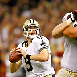 September 9, 2012; New Orleans, LA, USA; New Orleans Saints quarterback Drew Brees (9) throws a touchdown to tight end Jimmy Graham (not pictured) during the first quarter of a game against the Washington Redskins at the Mercedes-Benz Superdome. Mandatory Credit: Derick E. Hingle-US PRESSWIRE