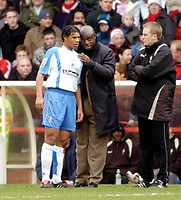Photo: Leigh Quinnell.<br /> Nottingham Forest v Swindon Town. Coca Cola League 1. 25/02/2006. Swindon boss Iffy Onuora gives Jerel Ifil somes new plans for the game.