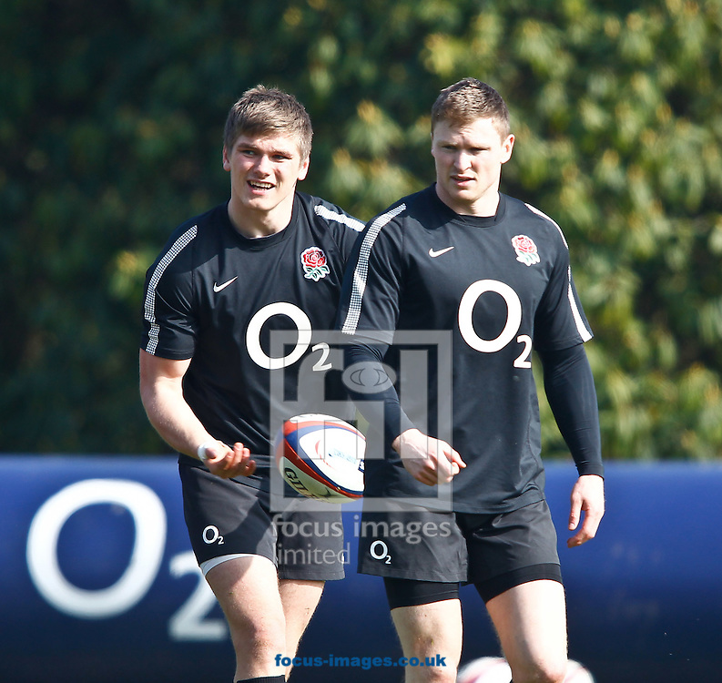 Picture by Andrew Tobin/Focus Images Ltd. 07710 761829 - 15/03/12 - Owen Farrell and Chris Ashton in action during the England team training session at Pennyhill Park, Surrey, prior to the last 2012 6-Nations match between England and Ireland.