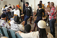 Middletown, New York - Members of the audience join Maxwell Kofi Donkor and the Sankofa Drum and Dance Ensemble in a performance at Thrall Library on Feb. 26, 2012.
