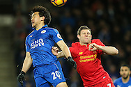Shinji Okazaki of Leicester City (left) competing with James Milner of Liverpool (right) during the Premier League match at the King Power Stadium, Leicester<br /> Picture by Andy Kearns/Focus Images Ltd 0781 864 4264<br /> 27/02/2017