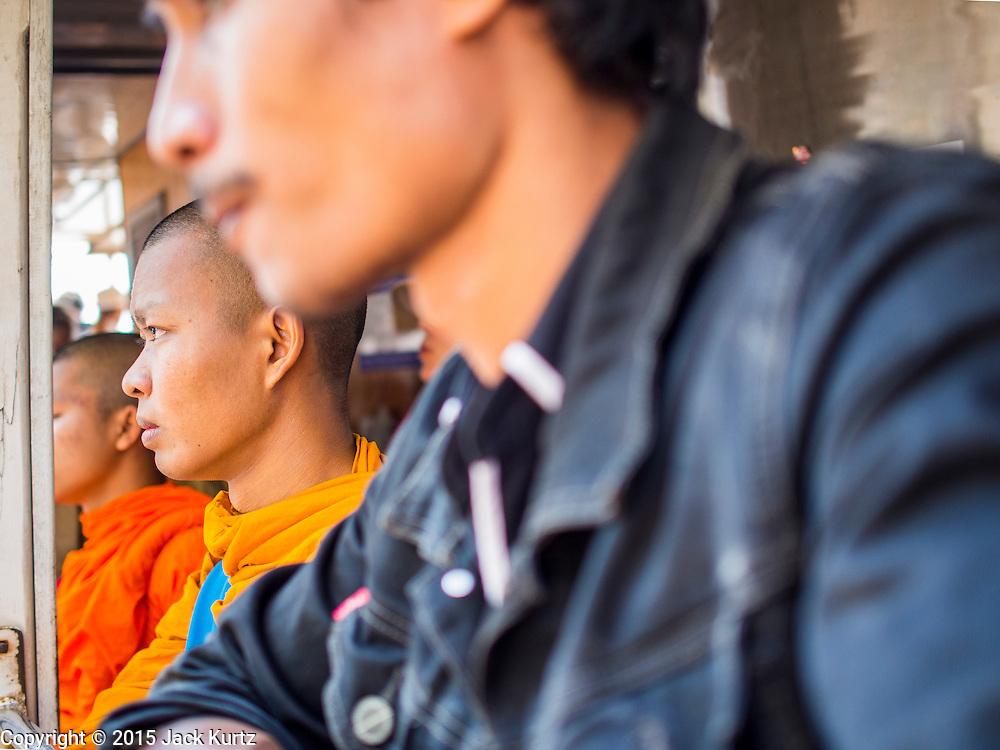 06 FEBRUARY 2015 - BANGKOK, THAILAND:  A Buddhist monk on a Chao Phraya River Express Boat in Bangkok.    PHOTO BY JACK KURTZ