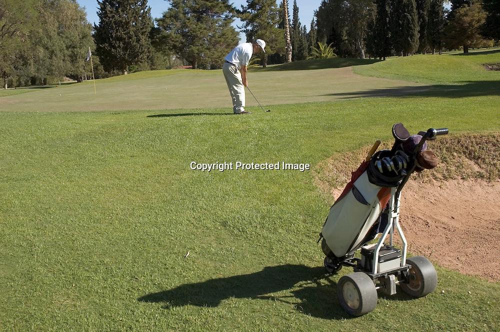 Senior Golfer playing