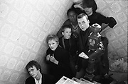 Group of young skinheads on the staircase of The Old Rectory, Cock Lane,High Wycombe, 1980.