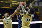Kent State Golden Flashes guard Jaylin Walker (23) shoots against Vanderbilt Commodores forward Simisola Shittu (11) and Commodores guard Joe Toye (2) during the second half of an NCAA basketball game in Nashville, Tenn., Friday, Nov. 23, 2018. Kent State won 77-75. (Jim Brown/Image of Sport)