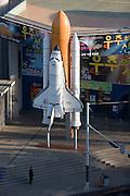 Jongno-gu. Miniature Space Shuttle in front of a cinema.