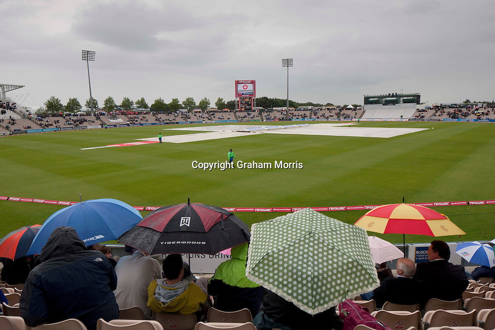 Spectators watch the rain fall during the third npower Test Match between England and Sri Lanka at the Rose Bowl, Southampton.  Photo: Graham Morris (Tel: +44(0)20 8969 4192 Email: sales@cricketpix.com) 17/06/11