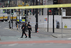 © Licensed to London News Pictures. 23/05/2017. Manchester, UK. Scene outside the Manchester Arena .  Police and other emergency services are seen near the Manchester Arena after reports of an explosion. Police have confirmed they are responding to an incident during an Ariana Grande concert at the venue. Photo credit: Joel Goodman/LNP