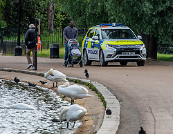 © Licensed to London News Pictures. 13/05/2020. London, UK. Police patrol Hyde Park. Members of the Public go out in Hyde Park as the Government relaxes the law on lockdown today to let people spend more time outside to enjoy the fresh air, picnics, sunbathing and meet other people while following social distancing guidelines. Photo credit: Alex Lentati/LNP