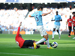 Manchester United's Ashley Young tackles Manchester City's Jesus Navas inside the box - Photo mandatory by-line: Dougie Allward/JMP - Tel: Mobile: 07966 386802 22/09/2013 - SPORT - FOOTBALL - City of Manchester Stadium - Manchester - Manchester City V Manchester United - Barclays Premier League